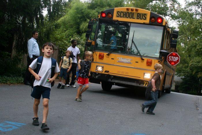 kids getting off school buskids getting off school bus