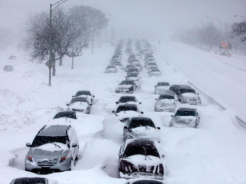 cars stranded on the road because of a snow storm