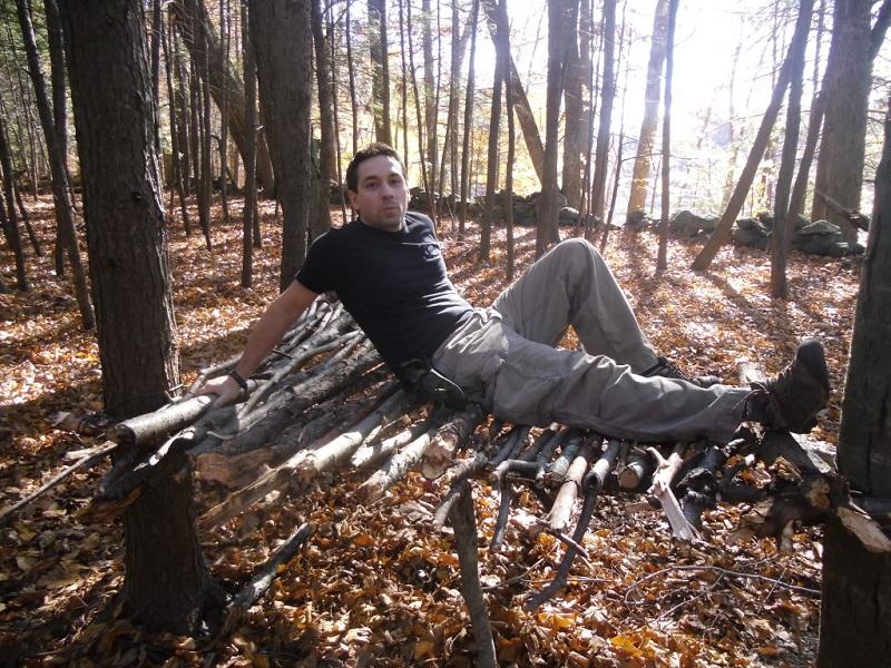 man sitting on a debris bed