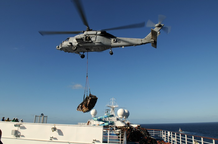 HH-60H delivering relief supplies to Carnival Splendor in 2010, one of the worst cruise ship disasters