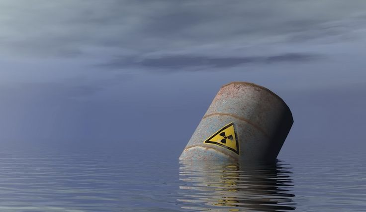 nuclear waste barrel floating in the water