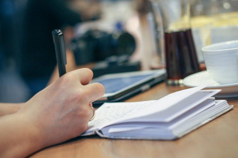 Man creating a disaster preparedness checklist.