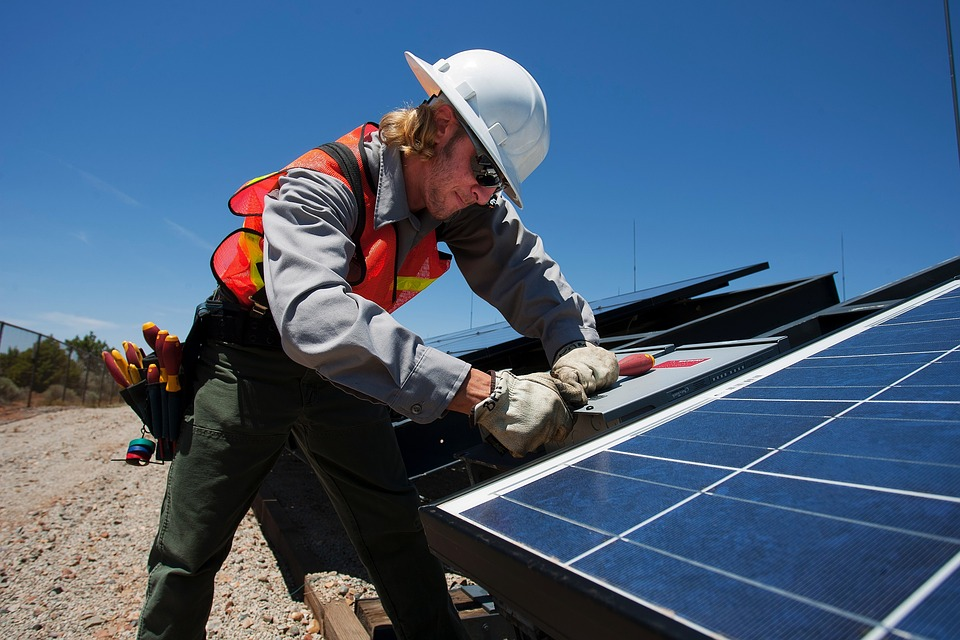 technician working on a solar panel installation on the ground