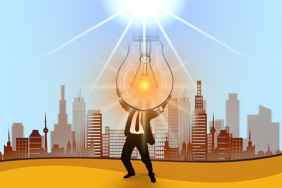orange and brown illustration of a man holding a giant lightbulb