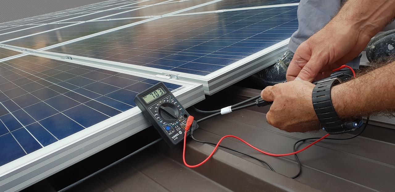 technician installing solar panels